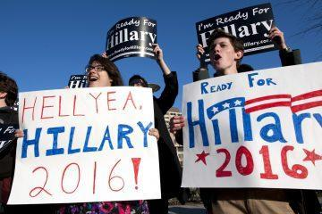 Supporters of Hillary Rodham Clinton demonstrate outside of the Kennedy Center in Washington, where the former Secretary of State is attending the Vital Voices Global Partnership 2013 Global Leadership Awards gala, Tuesday, April 2, 2013. (AP Photo/Cliff Owen)