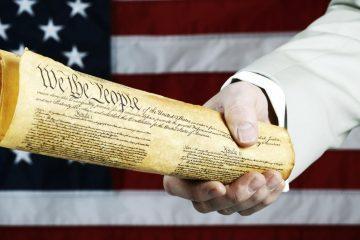 Man Holding US Constitution