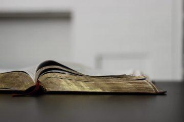 open-bible-dark-table
