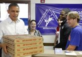U.S. President Barack Obama delivers pizza to volunteers at his campaign office in Williamsburg, Virginia, October 14, 2012. Obama is spending the weekend at a golf resort in Williamsburg to prepare for his next debate with Republican nominee Mitt Romney. REUTERS/Jonathan Ernst    (UNITED STATES - Tags: POLITICS ELECTIONS USA PRESIDENTIAL ELECTION)